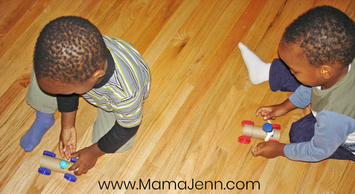 boys playing with TP Tube Race Cars