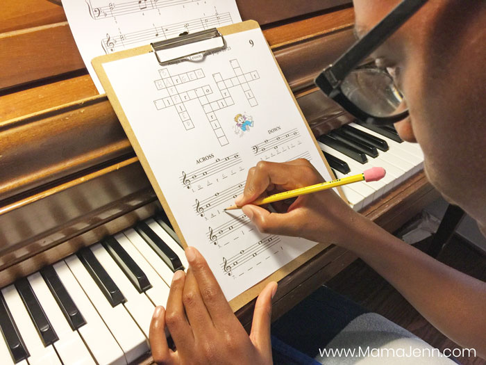 boy doing fun piano lesson cross-word puzzle