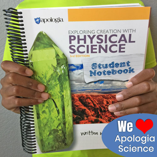 hands holding an Apologia Physical Science Student Notebook