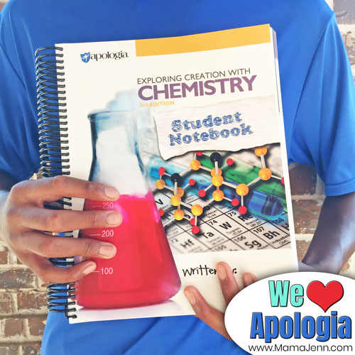 boy holding Apologia Chemistry Student Notebooks with text overlay We {heart} Apologia